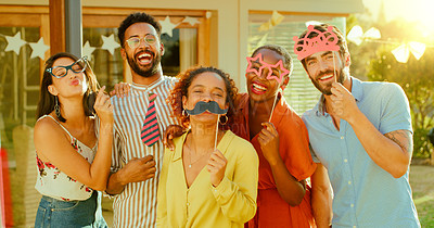 Buy stock photo Portrait of a group of young friends having fun with props during a get together in a garden at home