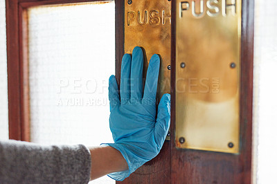 Buy stock photo Shot of an unrecognisable woman wearing gloves and opening a door