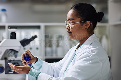 Buy stock photo Cropped shot of an attractive young female scientist sanitizing her hands regularly while working in the laboratory