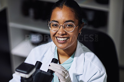 Buy stock photo Cropped portrait of an attractive young female scientist working on a microscope in her laboratory