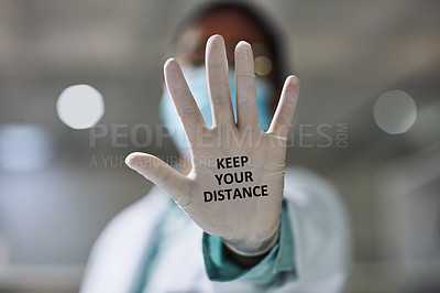 Buy stock photo Cropped shot of an unrecognizable female scientist holding out her gloved hand displaying the text