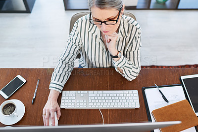Buy stock photo High angle shot of a mature businesswoman working on a computer in an office