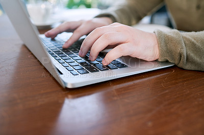 Buy stock photo Closeup shot of an unrecognisable businessman using a laptop in an office