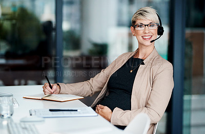 Buy stock photo Portrait of a pregnant businesswoman wearing a headset while working in an office