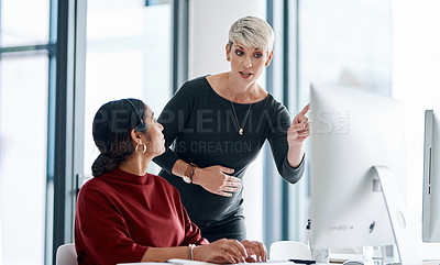 Buy stock photo Shot of a businesswoman helping a colleague in a call centre