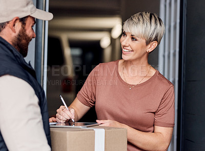 Buy stock photo Shot of a young woman signing for a delivery from the courier