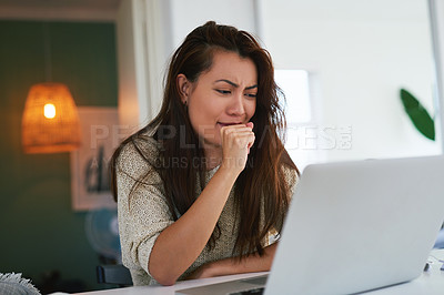 Buy stock photo Shot of an attractive young woman coughing while working from home