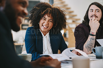 Buy stock photo Shot of a businesswoman looking happy while sitting in the boardroom with colleagues