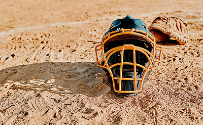 Buy stock photo Shot of a catcher's helmet lying on a baseball field