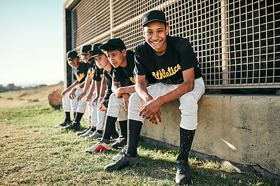 Buy stock photo Shot of a group of baseball players sitting together on a field