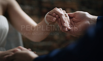 Buy stock photo Cropped shot of an unrecognisable couple holding hands on their wedding day