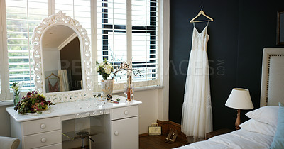 Buy stock photo Cropped shot of a wedding dress hanging in a room