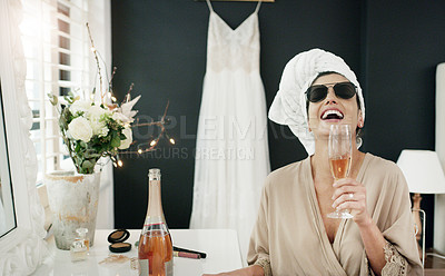 Buy stock photo Cropped shot of a woman having champagne while getting ready on her wedding day