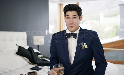 Buy stock photo Shot of a groomsman having a drink while preparing for his wedding