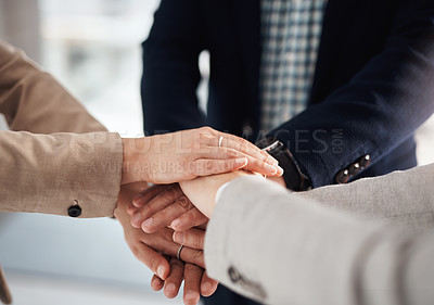 Buy stock photo Closeup shot of an unrecognisable group of businesspeople joining their hands together in a huddle