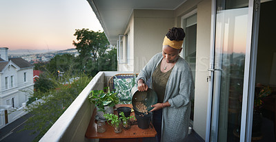 Buy stock photo Shot of a young woman gardening at home