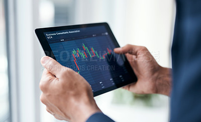 Buy stock photo Cropped shot of a businessman using a digital tablet to analyse financial data in a modern office