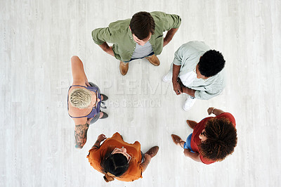 Buy stock photo High angle shot of a group of young businesspeople having a discussion in a modern office