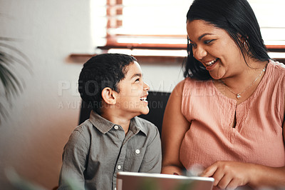 Buy stock photo Shot of a mother and her little son using a digital tablet together at home