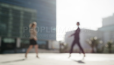 Buy stock photo Shot of two businesswomen walking through the city