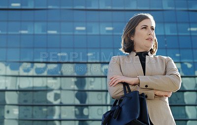 Buy stock photo Shot of a businesswoman waiting in anticipation against an urban background