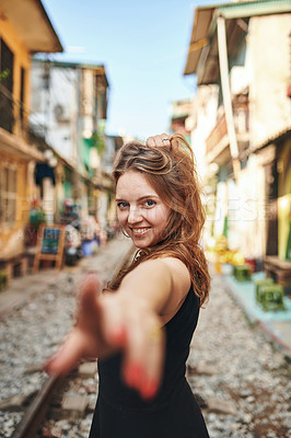 Buy stock photo Shot of a beautiful young woman exploring a foreign city