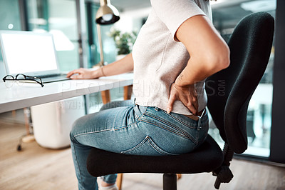 Buy stock photo Closeup shot of an unrecognisable businesswoman experiencing back pain while working in an office