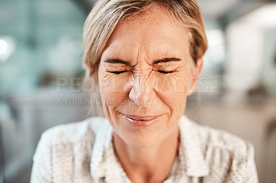 Buy stock photo Shot of a mature woman closing her eyes in pain