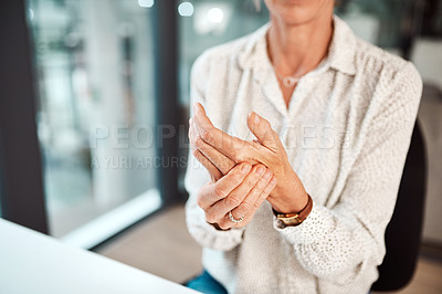 Buy stock photo Closeup shot of an unrecognisable businesswoman experiencing discomfort in her hand while working in an office