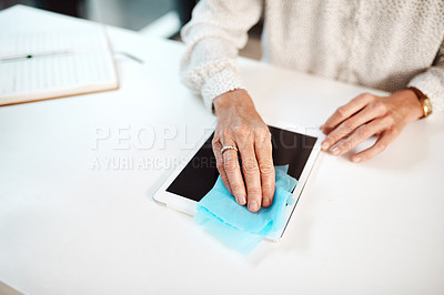 Buy stock photo Closeup shot of an unrecognisable businesswoman cleaning a digital tablet in an office