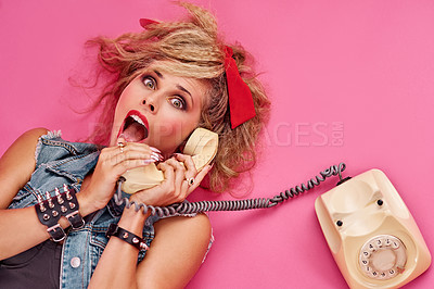 Buy stock photo Studio shot of a young woman holding a telephone while wearing 80s clothing