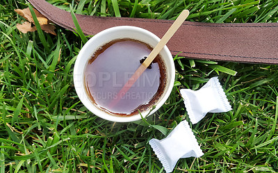 Buy stock photo Shot of a cup of freshly made tea outdoors on the lawn