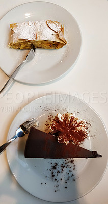 Buy stock photo Shot of a slice of delicious chocolate torte called sachertorte with apple strudel at a restaurant in Vienna