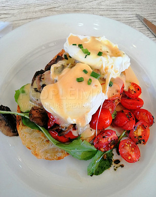 Buy stock photo Shot of a delicious breakfast meal served on a plate at a restaurant