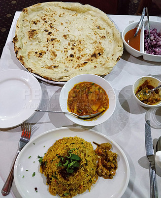 Buy stock photo Shot of assorted Bengalese dishes served on a table