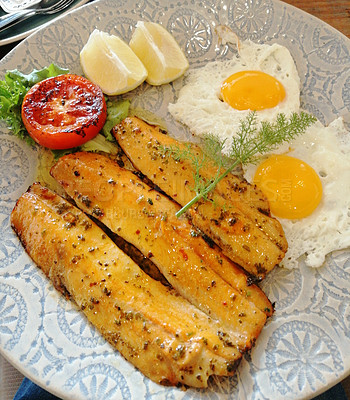 Buy stock photo Shot of haddock served with fried eggs on a plate