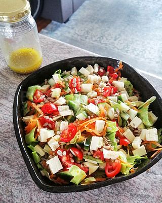 Buy stock photo Shot of a healthy handmade salad in a bowl on the kitchen counter at home