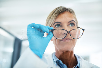 Buy stock photo Shot of a mature scientist looking thoughtful in a lab