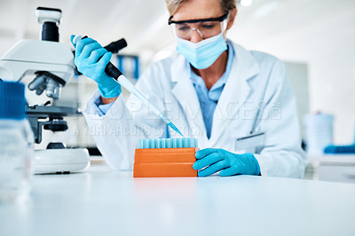 Buy stock photo Shot of a scientist using a dropper while working with samples in a lab