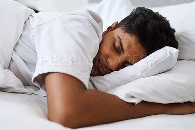 Buy stock photo Cropped shot of a young man sleeping in his bed