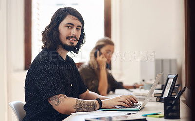 Buy stock photo Portrait of a young businessman working in an office with his colleague in the background