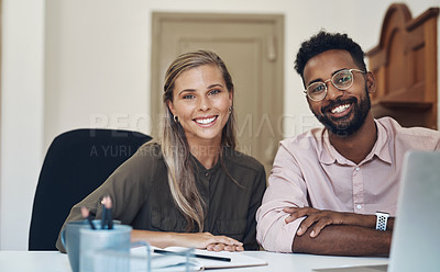 Buy stock photo Portrait of two businesspeople working together in an office