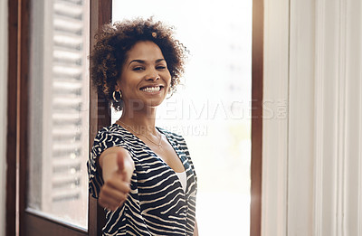 Buy stock photo Portrait of a young businesswoman showing thumbs in a modern office
