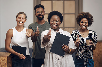 Buy stock photo Portrait of a group of young businesspeople showing thumbs in a modern office