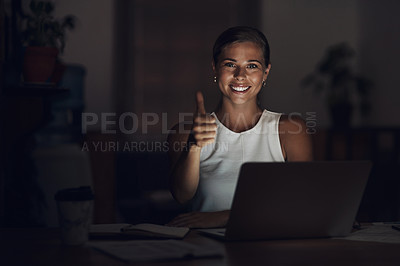 Buy stock photo Portrait of a young businesswoman using a laptop and showing thumbs up during a late night at work