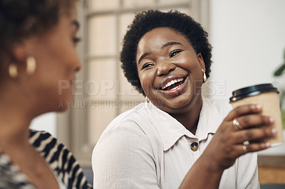 Buy stock photo Shot of two young businesswomen having coffee and a chat in a modern office