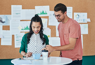 Buy stock photo Shot of a young businessman and businesswoman having a meeting in a modern office