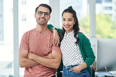 Buy stock photo Portrait of a confident young businessman and businesswoman working together in a modern office