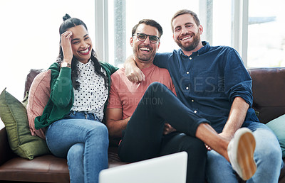Buy stock photo Portrait of two young men and a woman relaxing together on a sofa