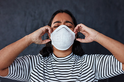 "Buy stock photo Studio shot of a young woman wearing a mask with ""I can't breathe"" in protest against racism"